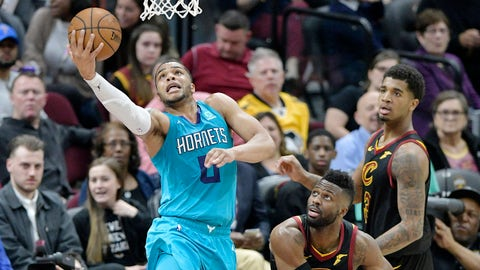Apr 9, 2019; Cleveland, OH, USA; Charlotte Hornets forward Miles Bridges (0) drives against Cleveland Cavaliers guard David Nwaba (12) and forward Marquese Chriss (3) in the third quarter at Rocket Mortgage FieldHouse. Mandatory Credit: David Richard-USA TODAY Sports