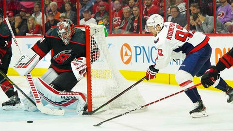 Apr 22, 2019; Raleigh, NC, USA;  Washington Capitals center Evgeny Kuznetsov (92) shoots the puck at Carolina Hurricanes goaltender Petr Mrazek (34) during the second period in game six of the first round of the 2019 Stanley Cup Playoffs at PNC Arena. Mandatory Credit: James Guillory-USA TODAY Sports