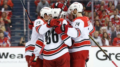 Apr 24, 2019; Washington, DC, USA; Carolina Hurricanes left wing Teuvo Teravainen (86) celebrates with teammates after scoring a goal against the Washington Capitals in the second period in game seven of the first round of the 2019 Stanley Cup Playoffs at Capital One Arena. Mandatory Credit: Geoff Burke-USA TODAY Sports