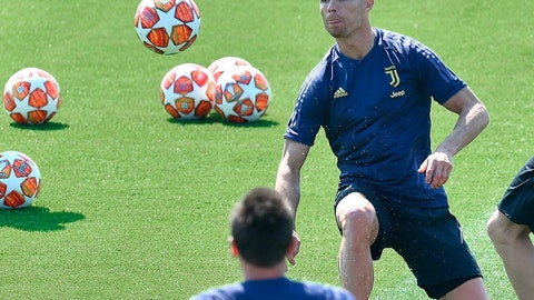 <p>               Juventus forward Cristiano Ronaldo eyes the ball during a training session on the eve of the first quarterfinal match against Ajax, in Turin, Italy, April 9, 2019. (Alessandro Di Marco/ANSA via AP)             </p>