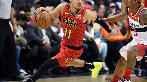 """<p>               FILE - In this Feb. 4, 2019, file photo, Atlanta Hawks guard Trae Young (11) dribbles the ball against Washington Wizards guard Bradley Beal (3) during the second half of an NBA basketball game, in Washington. A 29-win season may not look like much on paper, but first-year coach Lloyd Pierce says huge goals of establishing an identity and culture were """"home runs"""" for the team. At the core of the growth was rookie point guard Trae Young. (AP Photo/Nick Wass, File+)             </p>"""