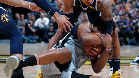<p>               Denver Nuggets guard Gary Harris, top, fights for control of the ball with San Antonio Spurs forward Rudy Gay in the first half of Game 7 of an NBA basketball first-round playoff series Saturday, April 27, 2019, in Denver. (AP Photo/David Zalubowski)             </p>