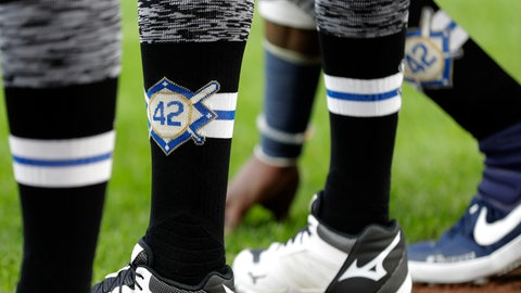 <p>               Seattle Mariners players wear No. 42 on their socks in honor of Jackie Robinson Day before a baseball game against the Cleveland Indians, Monday, April 15, 2019, in Seattle. (AP Photo/Ted S. Warren)             </p>
