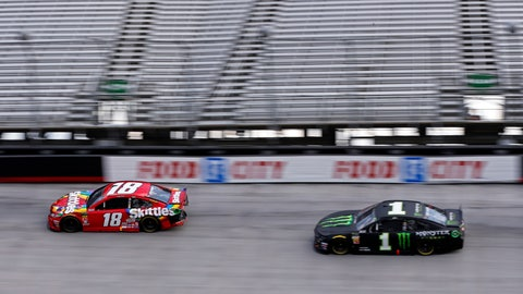 <p>               Kyle Busch (18) leads his brother Kurt Busch in the final laps of the NASCAR Cup Series auto race Sunday, April 7, 2019, at Bristol Motor Speedway in Bristol, Tenn. (AP Photo/Wade Payne)             </p>