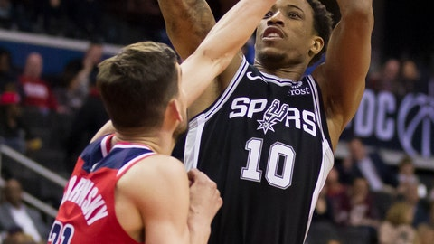 <p>               San Antonio Spurs guard DeMar DeRozan (10) shoots over Washington Wizards guard Tomas Satoransky (31) during the first half of an NBA basketball game Friday, April 5, 2019, in Washington. (AP Photo/Alex Brandon)             </p>
