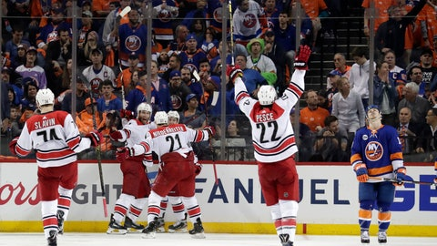 <p>               Carolina Hurricanes players celebrate after Jordan Staal, second from left, scored a goal on the New York Islanders during overtime of Game 1 of an NHL hockey second-round playoff series, Friday, April 26, 2019, in New York. The Hurricanes won 1-0. (AP Photo/Julio Cortez)             </p>