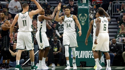 <p>               Milwaukee Bucks' Giannis Antetokounmpo gives high-fives to his teammates during the first half of Game 2 of an NBA basketball first-round playoff series against the Detroit Pistons on Wednesday, April 17, 2019, in Milwaukee. (AP Photo/Aaron Gash)             </p>