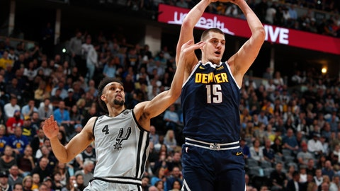 <p>               Denver Nuggets center Nikola Jokic, right, pulls in a rebound as San Antonio Spurs guard Derrick White defends in the first half of Game 7 of an NBA basketball first-round playoff series Saturday, April 27, 2019, in Denver. (AP Photo/David Zalubowski)             </p>