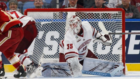 <p>               Massachusetts goalie Filip Lindberg (35) makes a save during the first period against Denver in a semifinal of the Frozen Four NCAA men's college hockey tournament Thursday, April 11, 2019, in Buffalo, N.Y. (AP Photo/Jeffrey T. Barnes)             </p>