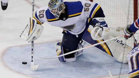 <p>               St. Louis Blues' Jordan Binnington stops a shot on the goal by the New York Rangers during the third period of an NHL hockey game Friday, March 29, 2019, in New York. The Rangers won 4-2. (AP Photo/Frank Franklin II)             </p>