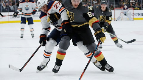 <p>               Edmonton Oilers left wing Milan Lucic (27) and Vegas Golden Knights right wing Mark Stone (61) vie for the puck during the first period of an NHL hockey game Monday, April 1, 2019, in Las Vegas. (AP Photo/John Locher)             </p>