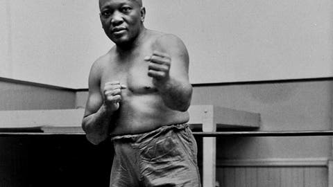 <p>               FILE - In this 1932 file photo, boxer Jack Johnson, the first black world heavyweight champion, poses in New York City.  A Texas Gulf Coast home where Johnson once lived has been heavily damaged in a fire. The blaze caused a wall to collapse in the vacant home Friday, April 5, 2019 in Galveston, Texas. Fire Chief Mike Wisko said that the building was in the process of being renovated. (AP Photo/File)             </p>
