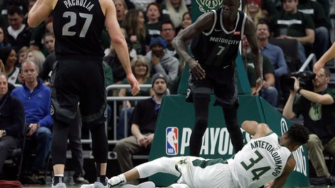 <p>               Milwaukee Bucks' Giannis Antetokounmpo (34) falls to the floor after being fouled by Detroit Pistons' Thon Maker (7) during the first half of Game 1 of an NBA basketball first-round playoff series Sunday, April 14, 2019, in Milwaukee. (AP Photo/Aaron Gash)             </p>