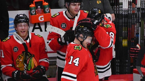 <p>               Chicago Blackhawks left wing Chris Kunitz (14) celebrates with right wing Patrick Kane (88) and center Jonathan Toews (19) after scoring a goal against the Dallas Stars during the second period of an NHL hockey game Friday, April 5, 2019, in Chicago. (AP Photo/Matt Marton)             </p>