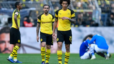 <p>               Dortmund's Axel Witsel and Dortmund's Paco Alcacer leave the pitch disappointed after losing the German Bundesliga soccer match between Borussia Dortmund and FC Schalke 04 in Dortmund, Germany, Saturday, April 27, 2019. Dortmund was defeated in the Derby by Schalke with 2-4. (AP Photo/Martin Meissner)             </p>