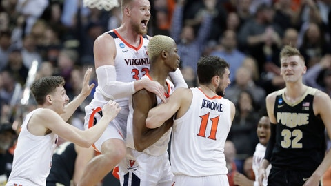 <p>               Virginia's Jack Salt (33) celebrates with teammates Mamadi Diakite and Ty Jerome (11) as Purdue's Matt Haarms (32) watches after Diakite hit a shot to send the game to overtime of the men's NCAA Tournament college basketball South Regional final game, Saturday, March 30, 2019, in Louisville, Ky. (AP Photo/Michael Conroy)             </p>