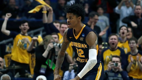 <p>               FILE - In this March 21, 2019, file photo, fans cheer as Murray State's Ja Morant (12) celebrates a basket during the second half of a first round men's college basketball game against Marquette in the NCAA Tournament, in Hartford, Conn. Morant was selected to The Associated Press All-America first team, Tuesday, April 2, 2019. (AP Photo/Elise Amendola, File)             </p>