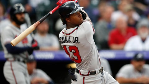 <p>               Atlanta Braves' Ronald Acuna Jr. follows the flight of his two-run home run off Colorado Rockies starting pitcher Kyle Freeland in the first inning of a baseball game Monday, April 8, 2019, in Denver. (AP Photo/David Zalubowski)             </p>