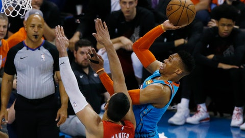 <p>               Oklahoma City Thunder guard Russell Westbrook, right, shoots in front of Portland Trail Blazers center Enes Kanter (00) I the first half of Game 3 of an NBA basketball first-round playoff series Friday, April 19, 2019, in Oklahoma City. (AP Photo/Sue Ogrocki)             </p>