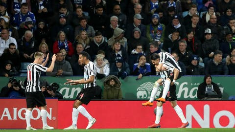 <p>               Newcastle United's Ayoze Perez bottom right celebrates scoring his side's first goal of the game, during the English Premier League soccer match between Leicester City and Newcastle United, at The King Power Stadium, in  Leicester England, Friday April 12, 2019. (Nick Potts/PA via AP)             </p>