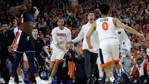 <p>               Virginia players celebrate after defeating Auburn 63-62 in the semifinals of the Final Four NCAA college basketball tournament, Saturday, April 6, 2019, in Minneapolis. (AP Photo/David J. Phillip)             </p>