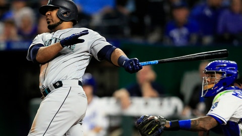 <p>               Seattle Mariners first baseman Edwin Encarnacion hits a three-run home run off Kansas City Royals relief pitcher Kevin McCarthy during the sixth inning of a baseball game at Kauffman Stadium in Kansas City, Mo., Monday, April 8, 2019. It was the second home run of the inning for Encarnacion. (AP Photo/Orlin Wagner)             </p>