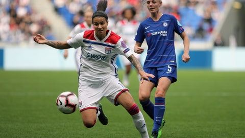 <p>               Lyon's Delphine Cascarino, left, challenges for the ball with Chelsea's Sophie Ingle, right, during their Women's Champions League semifinal soccer match in Decines, France, Sunday, April 21, 2019. (AP Photo/Laurent Cipriani)             </p>
