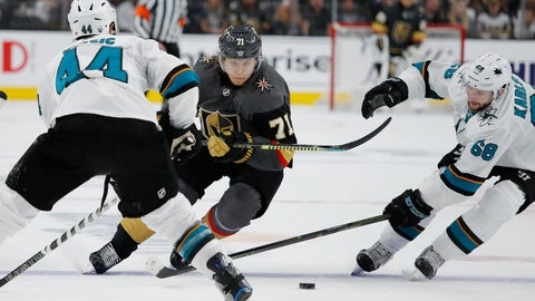 <p>               Vegas Golden Knights center William Karlsson (71) skates between San Jose Sharks defenseman Marc-Edouard Vlasic, left, and center Melker Karlsson during the second period in Game 6 of a first-round NHL hockey playoff series Sunday, April 21, 2019, in Las Vegas. (AP Photo/John Locher)             </p>