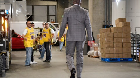 <p>               Magic Johnson walks toward members of the Los Angeles Lakers' band as he leaves the building prior to an NBA basketball game between the Lakers and the Portland Trail Blazers on Tuesday, April 9, 2019, in Los Angeles. Johnson abruptly quit as the Lakers' president of basketball operations Tuesday night, citing his desire to return to the simpler life he enjoyed as a wealthy businessman and beloved former player before taking charge of the franchise just over two years ago. (AP Photo/Mark J. Terrill)             </p>