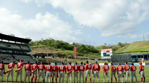 <p>               FILE - In this Feb. 10, 2019 file photo, Cuba's Los Leneros de las Tunas baseball players listen to their national anthem before facing Panama's Los Toros de Herrera for the final, Caribbean Series baseball tournament championship game at Rod Carew stadium in Panama City. The Trump administration is moving to end a deal allowing Cuban baseball players to sign contracts directly with Major League Baseball organizations, which appears to once again require Cuban players to cut ties with their national program before signing with MLB.  (AP Photo/Arnulfo Franco, File)             </p>