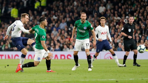 <p>               Tottenham's Christian Eriksen, left, scores his side's first goal during the English Premier League soccer match between Tottenham Hotspur and Brighton & Hove Albion at Tottenham Hotspur stadium in London, Tuesday, April 23, 2019.(AP Photo/Frank Augstein)             </p>