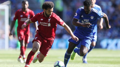 <p>               Liverpool's Mohamed Salah and Cardiff City's Bruno Ecuele Manga, right, battle for the ball during the English Premier League soccer match at The Cardiff City Stadium, Cardiff, Wales, Sunday April 21, 2019. (David Davies/PA via AP)             </p>