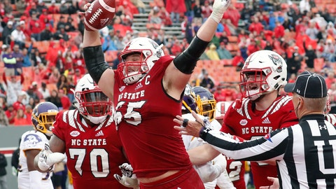 <p>               FILE - In this Dec. 1, 2018, file photo, North Carolina State's Garrett Bradbury (65) celebrates after he scored a touchdown during the second half of NCAA college football game, in Raleigh, N.C.Bradbury is a possible pick in the 2019 NFL Draft. (AP Photo/Chris Seward, File)             </p>
