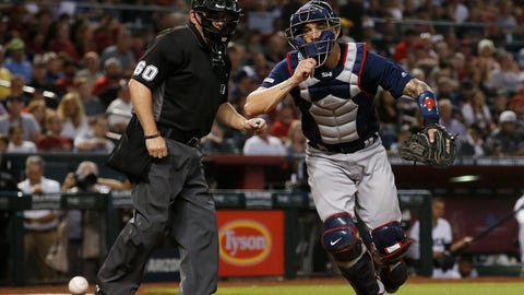 <p>               Boston Red Sox catcher Blake Swihart, right, runs after a pitch that got away as umpire Marty Foster (60) looks on during the fourth inning of an opening day baseball game against the Arizona Diamondbacks, Friday, April 5, 2019, in Phoenix. (AP Photo/Ross D. Franklin)             </p>