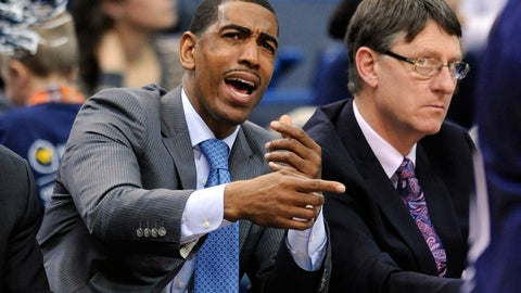 <p>               FILE - In this Dec. 6, 2013, file photo, then-Connecticut head coach Kevin Ollie signals to his team as associate head coach Glenn Miller looks on during the first half of Connecticut's 95-68 victory over Maine in an NCAA college basketball game, in Hartford, Conn. Former UConn basketball coach Kevin Ollie has filed a lawsuit against former assistant Glenn Miller, contending Miller slandered him in comments to the NCAA. Miller told the governing body he had learned about an alleged $30,000 payment Ollie made to the mother of a recruit while at UConn. Ollie's lawsuit, filed Monday, April 29, 2019, in Connecticut Superior Court, says that accusation was false and damaged his reputation.  (AP Photo/Fred Beckham, File)             </p>