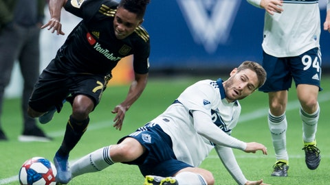 <p>               Vancouver Whitecaps midfielder Ion Erice, lower right, fights for control of the ball with Los Angeles FC forward Latif Blessing (7) during the first half of an MLS soccer match Wednesday, April 17, 2019, in Vancouver, British Columbia. (Jonathan Hayward/The Canadian Press via AP)             </p>
