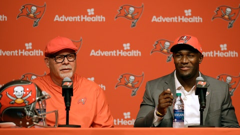 <p>               Tampa Bay Buccaneers first-round draft pick Devin White, right, gestures as he sits with head coach Bruce Arians during an NFL football news conference Friday, April 26, 2019, in Tampa, Fla. White, a linebacker, played college football at LSU. (AP Photo/Chris O'Meara)             </p>