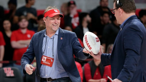 <p>               FILE - In this Jan. 2, 2019, file photo, Dana Holgorsen, the newly named football coach for the Houston college football team, gets autographed footballs to toss to the crowd as he is recognized during halftime of an NCAA college basketball game between Tulsa and Houston, in Houston. (AP Photo/Michael Wyke, File)             </p>