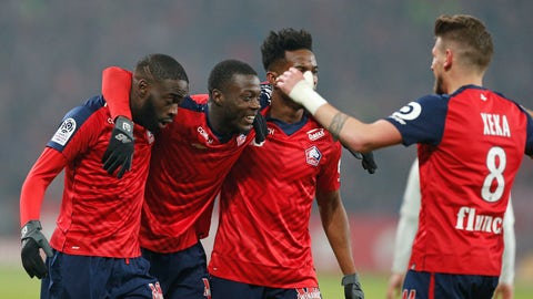 <p>               Lille players celebrate after PSG's Thomas Meunier scored an own goal during the French League One soccer match between OSC Lille and Paris-Saint-Germain at Stade Pierre Mauroy in Lille, France, Sunday, April 14, 2019.(AP Photo/Michel Spingler)             </p>