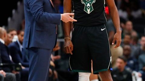 <p>               Milwaukee Bucks head coach Mike Budenholzer, left, speaks with guard Sterling Brown (23) in the first half of an NBA basketball game against the Atlanta Hawks on Sunday, March 31, 2019, in Atlanta. (AP Photo/Todd Kirkland)             </p>
