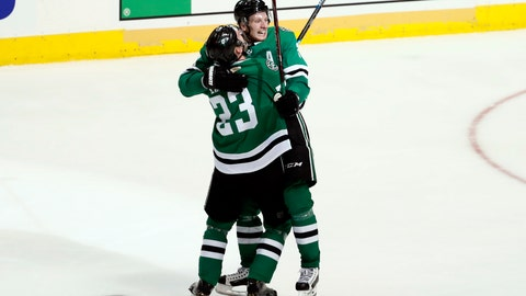 <p>               Dallas Stars' Esa Lindell (23) celebrates with John Klingberg after Klingberg scored in overtime against the Nashville Predators in Game 6 of an NHL hockey first-round playoff series in Dallas, Monday, April 22, 2019. The Stars won 2-1 in overtime. (AP Photo/Tony Gutierrez)             </p>