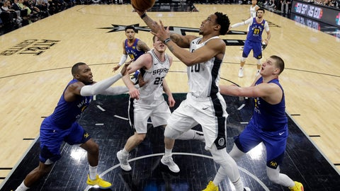 <p>               San Antonio Spurs guard DeMar DeRozan (10) drives to the basket against Denver Nuggets forward Paul Millsap (4) and center Nikola Jokic (15) during the second half of Game 6 of an NBA basketball playoff series, Thursday, April 25, 2019, in San Antonio. San Antonio won 120-103. (AP Photo/Eric Gay)             </p>