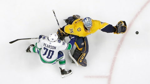 <p>               Nashville Predators goaltender Pekka Rinne (35), of Finland, comes away from the net to grab the puck as Vancouver Canucks left wing Tanner Pearson (70) closes in during the second period of an NHL hockey game Thursday, April 4, 2019, in Nashville, Tenn. (AP Photo/Mark Humphrey)             </p>