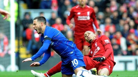 <p>               Chelsea's Eden Hazard, left, duels for the ball with Liverpool's Fabinho during the English Premier League soccer match between Liverpool and Chelsea at Anfield stadium in Liverpool, England, Sunday, April 14, 2019. (AP Photo/Rui Vieira)             </p>