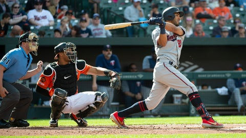 <p>               Minnesota Twins' Eddie Rosario, right, hits a solo home run in the second inning of a baseball game against the Baltimore Orioles, Saturday, April 20, 2019, in Baltimore. (AP Photo/Tommy Gilligan)             </p>