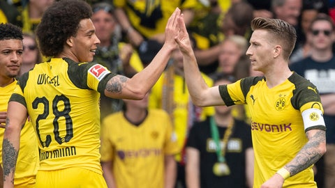 <p>               Dortmund's scorer Marco Reus celebrates his goal with Axel Witsel, left, during the German Bundesliga soccer match between SC Freiburg and Borussia Dortmund in Freiburg, Germany, Sunday, April 21, 2019.  (Patrick Seeger/dpa via AP)             </p>