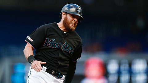 <p>               Miami Marlins' Austin Dean rounds third base before scoring on a double by Lewis Brinson during the second inning of a baseball game against the Philadelphia Phillies on Saturday, April 13, 2019, in Miami. (AP Photo/Brynn Anderson)             </p>