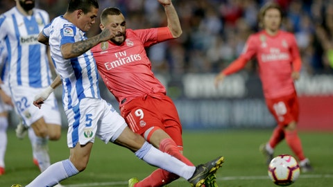 <p>               Real Madrid's Karim Benzema duels for the ball against Leganes' Jonathan Cristian, left, Silva during a Spanish La Liga soccer match in Leganes, outskirts Madrid, Spain, Monday, April 15, 2019. (AP Photo/Bernat Armangue)             </p>