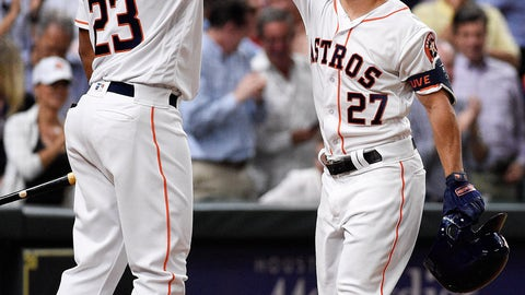 <p>               Houston Astros' Jose Altuve (27) celebrates his solo home run off New York Yankees starting pitcher Jonathan Loaisiga with Michael Brantley during the third inning of a baseball game against the New York Yankees, Tuesday, April 9, 2019, in Houston. The home run was Altuve's 100th for his career. (AP Photo/Eric Christian Smith)             </p>