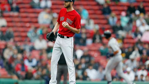 <p>               Boston Red Sox's Chris Sale stands on the mound after giving up a solo home run to Detroit Tigers' Grayson Greiner, right, during the fifth inning in the first game of a baseball doubleheader in Boston, Tuesday, April 23, 2019. (AP Photo/Michael Dwyer)             </p>